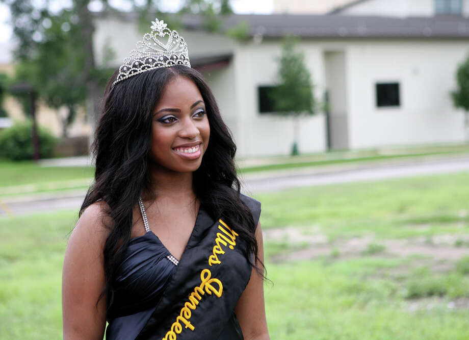 Miss Juneteenth Amber Walker smiles for pictures June 15, 2013 before getting on a float for the 15th Annual Juneteenth Freedom Parade. The parade is put on by the Juneteenth Freedom Coalition. Photo: Cynthia Esparza, For San Antonio Express-News / For San Antonio Express-News