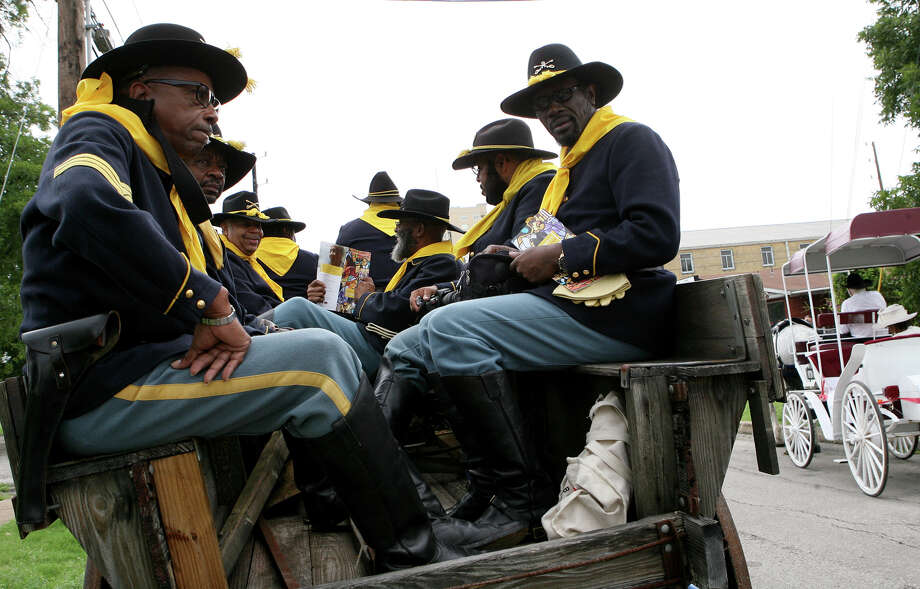 Buffalo Soldiers prepare to start the 15th Annual Juneteenth Freedom Parade route June 15, 2013. The parade is put on by the Juneteenth Freedom Coalition. Photo: Cynthia Esparza, For San Antonio Express-News / For San Antonio Express-News