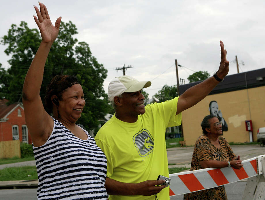 Mary and Harold Moore wave to participants in the 15th Annual Juneteenth Freedom Parade June 15, 2013 on East Commerce Street. The parade is put on by the Juneteenth Freedom Coalition. Photo: Cynthia Esparza, For San Antonio Express-News / For San Antonio Express-News