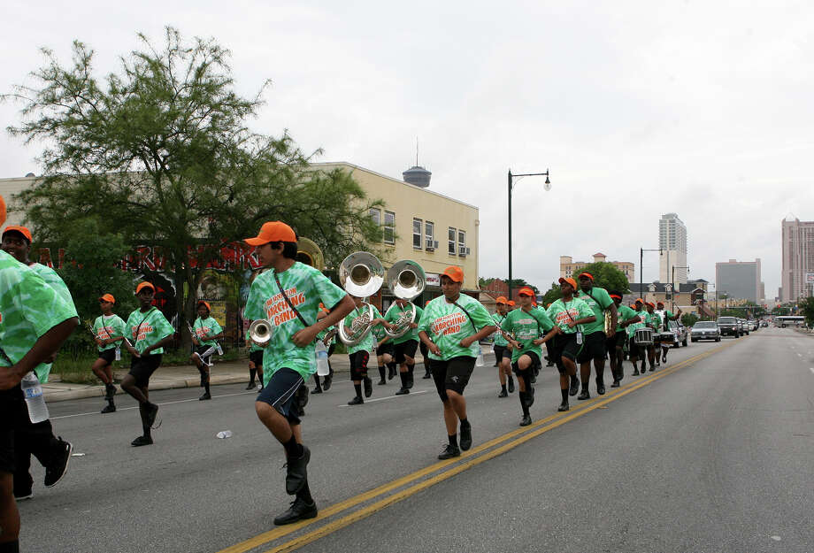 The Sam Houston High School band participates in the 15th Annual Juneteenth Freedom Parade June 15, 2013. The parade is put on by the Juneteenth Freedom Coalition and started at the intersection of Cherry and East Commerce and went the Second Baptist Church on Commerce. Photo: Cynthia Esparza, For San Antonio Express-News / For San Antonio Express-News