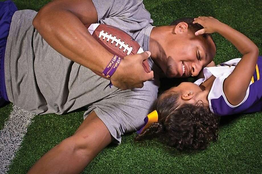 Eric Reid learned he'd be a father while still in high school, and he combined college at LSU with parental duties. Photo: -, Courtesy Reid Family