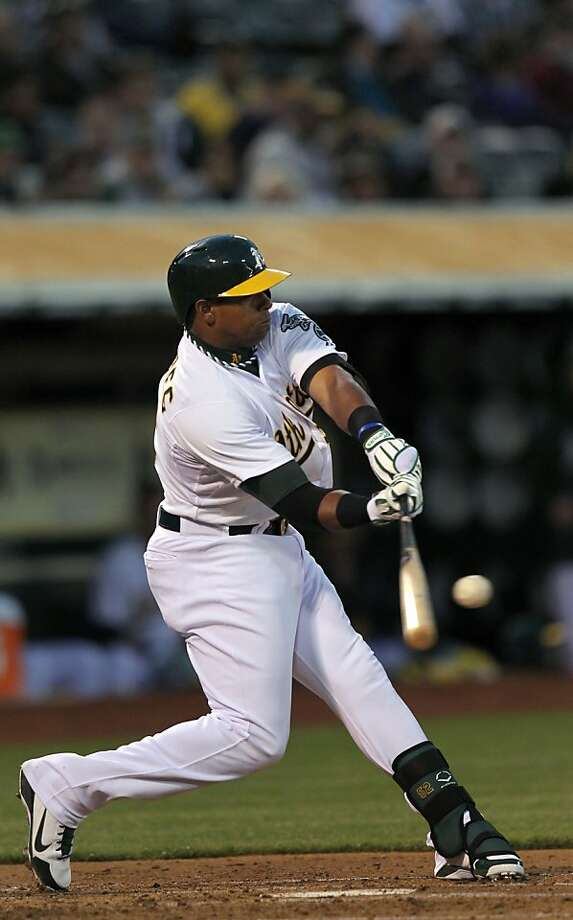 Oakland Athletics Yoenis Cespedes (52) hits a solo home run in the second inning during their MLB baseball game against the Seattle Mariners Tuesday, April 2, 2013 in Oakland, Calif. Photo: Lance Iversen, The Chronicle