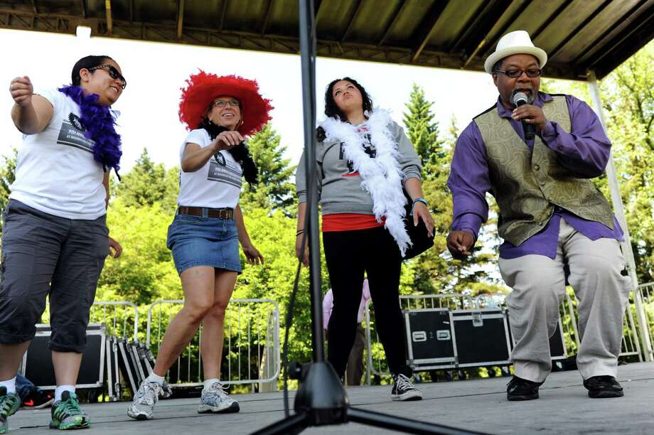 "Rosalie Phan, left, Sue Cleary, center, and Kimmi Michael, right, join Donald ""Soul Man"" Hyman in singing Motown classics during the Juneteenth Celebration on Saturday, June 15, 2013, at Washington Park in Albany, N.Y. Juneteenth symbolizes the end of slavery, and for many African-Americans, it has come to mean what Fourth of July means for all Americans: Freedom. (Cindy Schultz / Times Union) Photo: Cindy Schultz / 00022642A"