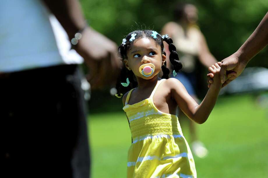 Kamaria Shabazz, 3, of Albany attends the Juneteenth Celebration on Saturday, June 15, 2013, at Washington Park in Albany, N.Y. Juneteenth symbolizes the end of slavery, and for many African-Americans, it has come to mean what Fourth of July means for all Americans: Freedom. (Cindy Schultz / Times Union) Photo: Cindy Schultz / 00022642A