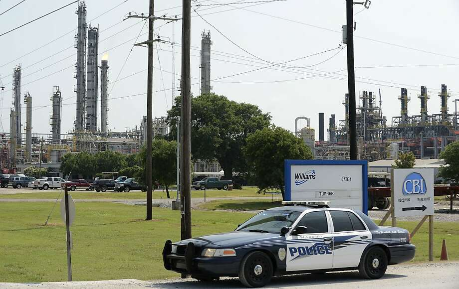 A police car is parked outside the Williams Olefins Plant on Friday, June 13, 2013 after an explosion and fire in Geismar, La. on Thursday. A second victim of the explosion died Friday, while federal authorities opened an investigation to determine the cause of the deadly blast. (AP Photo/The Baton Rouge Advocate, Arthur D. Lauck) Photo: Arthur D. Lauck, Associated Press