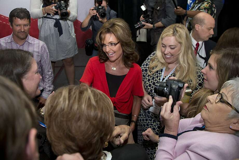 Sarah Palin (center), with husband Todd Palin (upper left), greet supporters at the Faith and Freedom Coalition forum. Photo: Carolyn Kaster, Associated Press