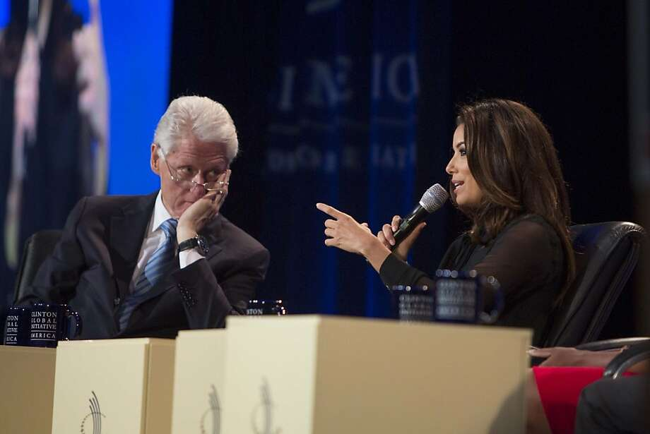 Bill Clinton listens to Eva Longoria speak at a Clinton Global Initiative meeting Thursday in Chicago. Photo: Scott Eisen, Associated Press
