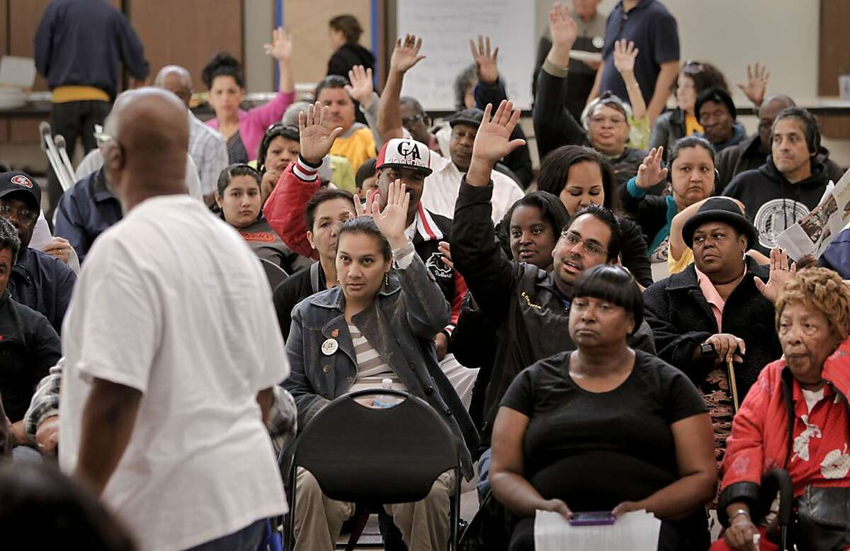 Morris LeGrande, (left) with ACCE, (Alliance of Californians for Community Empowerment) asks for a show of hands of homes currently underwater, during a public meeting the Nevin Community Center in Richmond, Calif. on Saturday June 15, 2013. A radical new program is being proposed as a way to help struggling homeowners that could lead the city to use eminent domain to seize underwater mortgages and restructure them to keep families in their homes.