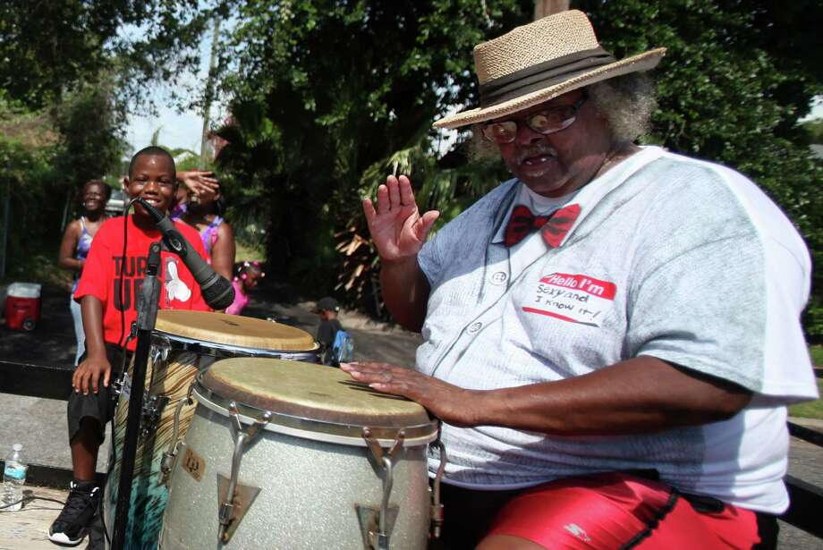 James J.O. Johnson performs while riding a float during the Galveston Juneteenth Parade on Saturday, June 15, 2013, in Houston. Photo: Mayra Beltran / © 2013 Houston Chronicle