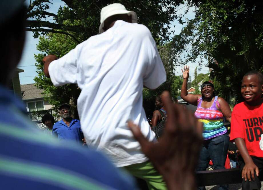 Kimberly Saxton dances to the music during the Galveston Juneteenth Parade on Saturday, June 15, 2013, in Houston. Photo: Mayra Beltran / © 2013 Houston Chronicle
