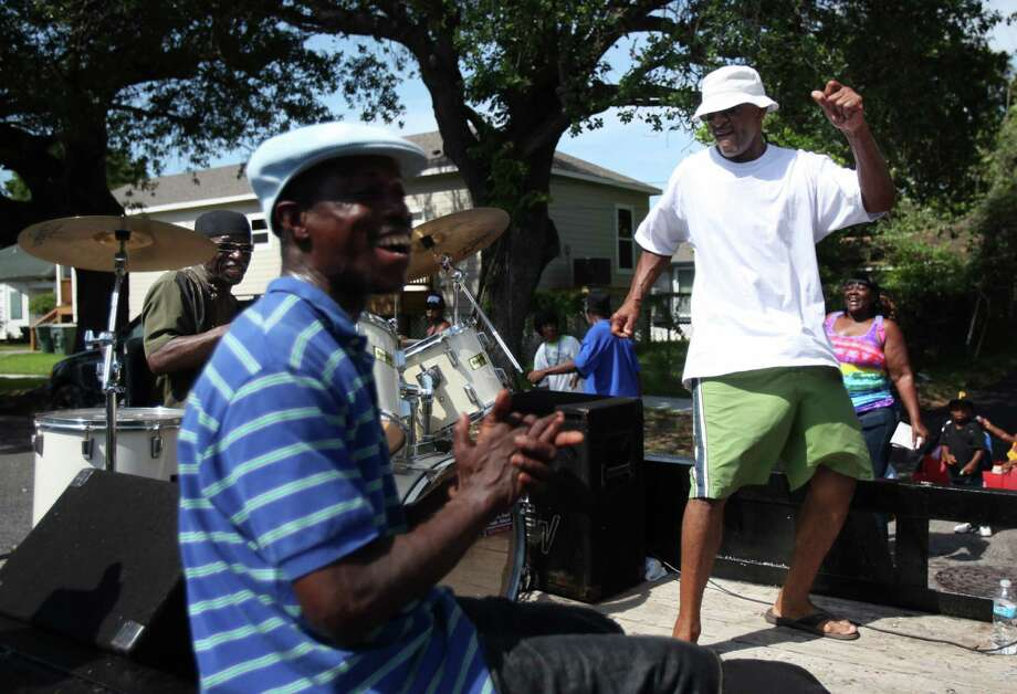 Thomas Allen claps while Odell Parish dances on the float during the Galveston Juneteenth Parade on Saturday, June 15, 2013, in Houston. Photo: Mayra Beltran / © 2013 Houston Chronicle