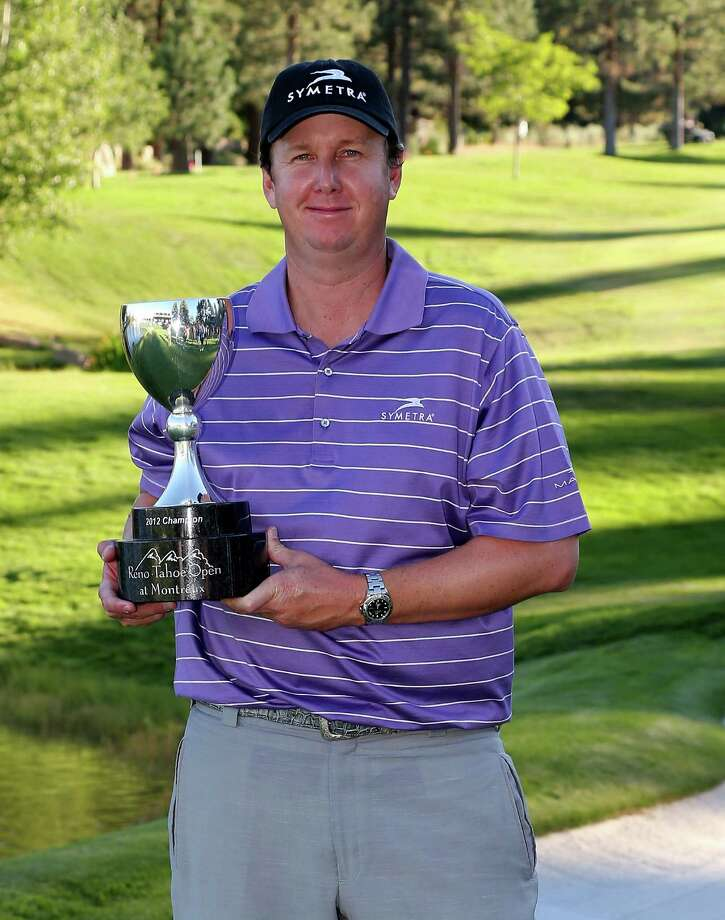 RENO, NV - AUGUST 05:  J.J. Henry poses with the trophy after his win during the final round of the Reno-Tahoe Open on August 5, 2012 at Montreux Golf and Country Club in Reno, Nevada. Photo: Stephen Dunn, Getty Images / 2012 Getty Images