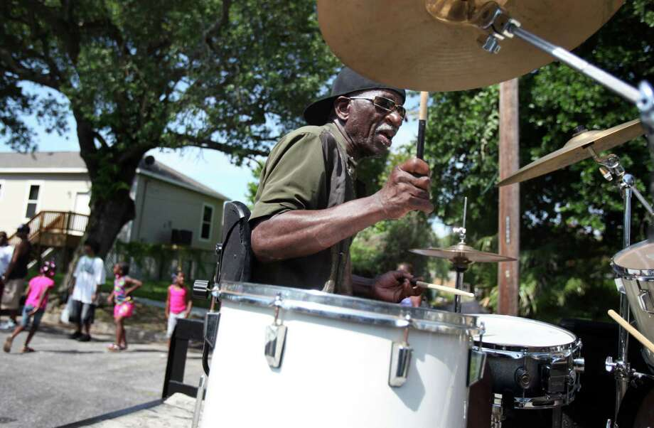 Aaron Josey plays the drums during the Galveston Juneteenth Parade on Saturday, June 15, 2013, in Houston. Photo: Mayra Beltran / © 2013 Houston Chronicle
