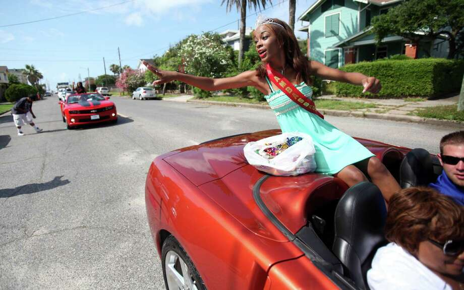 Above: Jahnee Lee is riding high on the lead Corvette as  Saturday's  Juneteenth Parade winds through Galveston's streets. Photo: Mayra Beltran, Staff / © 2013 Houston Chronicle