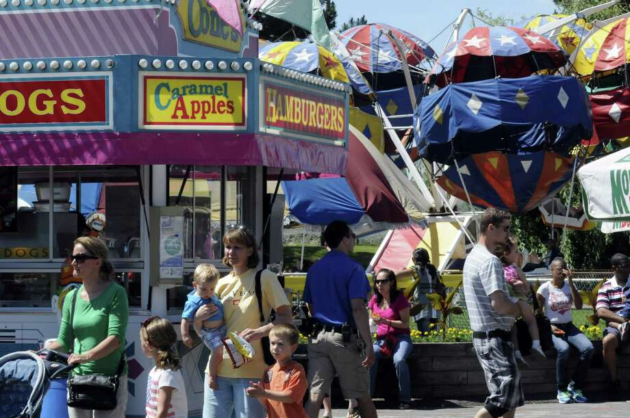 A typical busy weekend of family fun at Hoffmans Playland on Saturday June 15, 2013 in Latham, N.Y. (Michael P. Farrell/Times Union) Photo: Michael P. Farrell