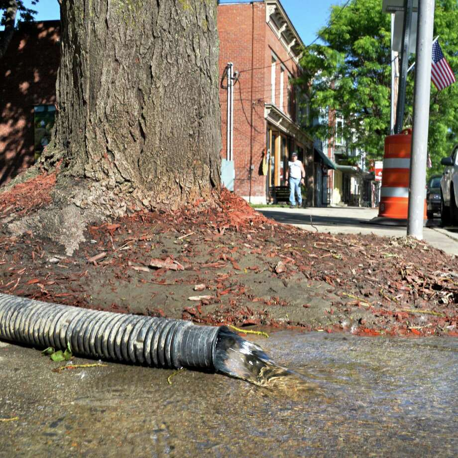 Water is pumped out of a cellar out onto Main Street Saturday June 15, 2013, following yesterday's flashflood in Middleburgh, NY.   (John Carl D'Annibale / Times Union) Photo: John Carl D'Annibale / 10022833A
