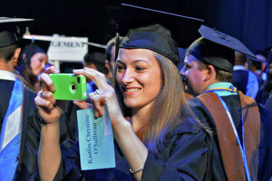 Kaitlin O'Sullivan of Saratoga Springs, photographs class mates during Union Graduate College commencement at Proctor's Theatre in Schenectady, NY, Saturday June 15, 2013.  (John Carl D'Annibale / Times Union) Photo: John Carl D'Annibale / 00022707A