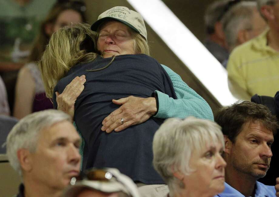 During a meeting on the Black Forest Fire, Marlice Van Zandt (facing camera) hugs Linette Perschke, who lost her home in the fire. The fire was 55 percent contained by Saturday evening. Photo: Marcio Jose Sanchez / Associated Press