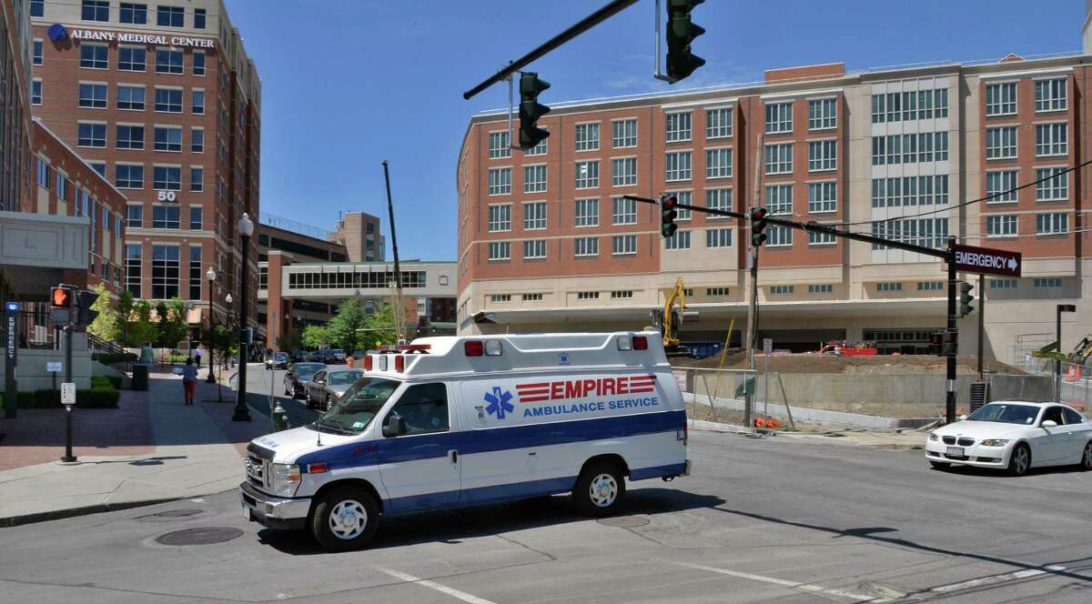 An ambulance leaves Albany Medical Center on Myrtle Avenue in the city's Park South neighborhood in Albany, NY, Wednesday June 5, 2013. (John Carl D'Annibale / Times Union)