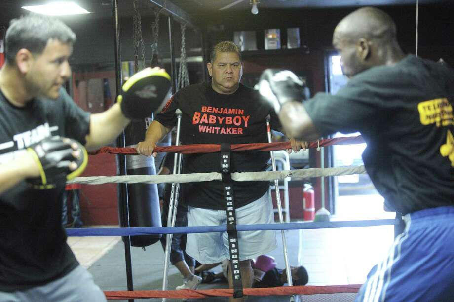 """Rick Morones Sr. (middle) watches his son Rick Jr. (left) train Benjamin """"Baby Boy"""" Whitaker, one of the city's top prospects, at Team Morones Gym. Photo: Billy Calzada / San Antonio Express-News"""