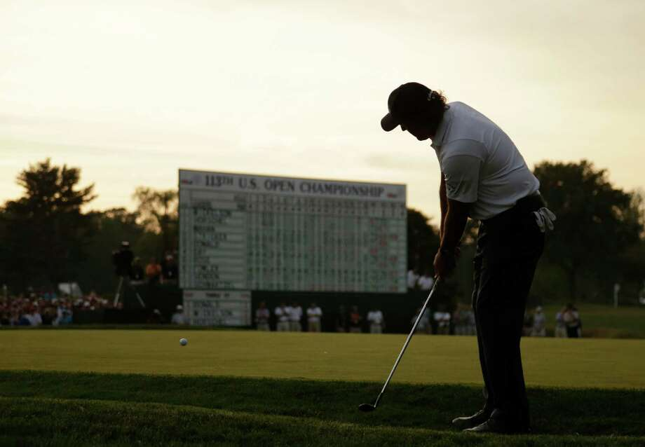 Phil Mickelson chips onto the 18th green during the third round of the U.S. Open golf tournament at Merion Golf Club, Saturday, June 15, 2013, in Ardmore, Pa. (AP Photo/Gene J. Puskar) Photo: Gene J. Puskar, Associated Press / AP