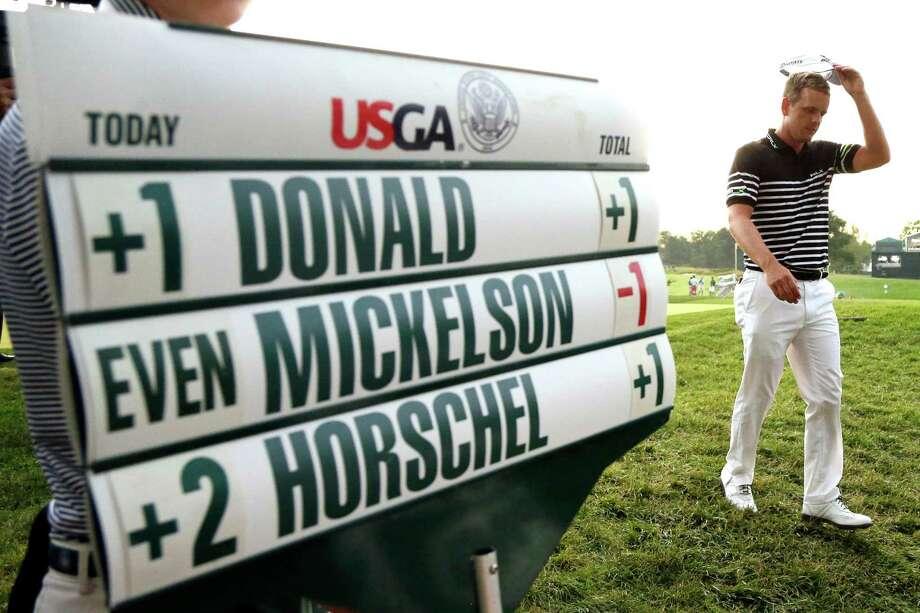 Luke Donald, of England, walks off the 18th green after the third round of the U.S. Open golf tournament at Merion Golf Club, Saturday, June 15, 2013, in Ardmore, Pa. (AP Photo/Gene J. Puskar) Photo: Gene J. Puskar, Associated Press / AP