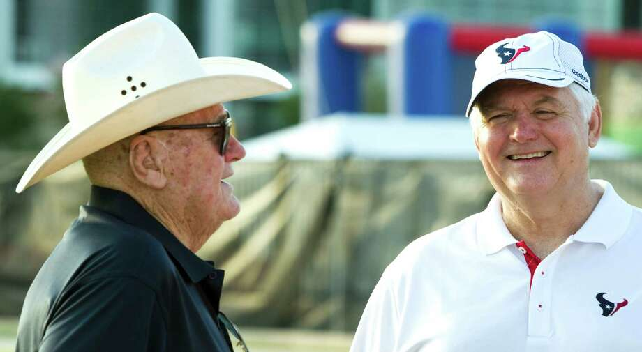 Former Oilers coach Bum Phillips, left, and his son, Texans defensive coordinator Wade Phillips, have made up for lost time later on in life. Photo: Brett Coomer, Staff / © 2010 Houston Chronicle