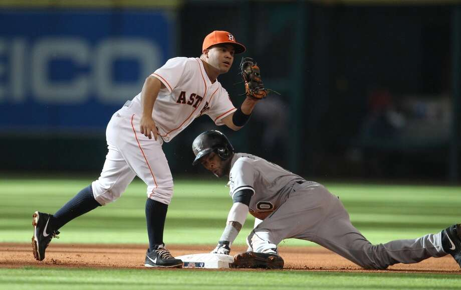 Astros second baseman Jose Altuve tries to get the tag on White Sox shortstop Alexei Ramirez as he steals second.