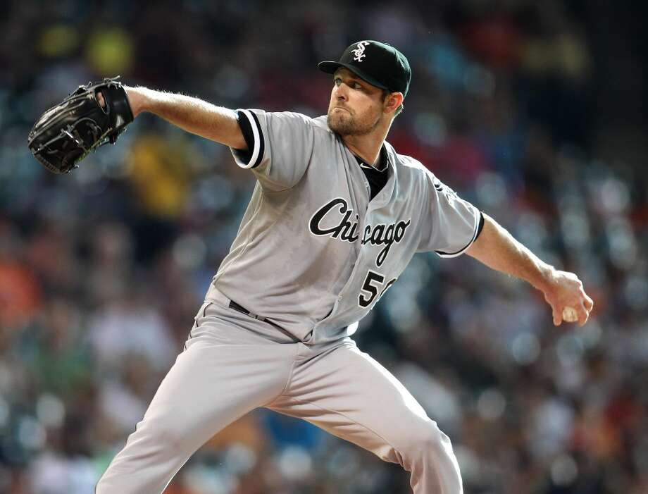 White Sox starting pitcher John Danks pitches during the first inning.