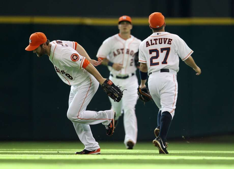 Astros second baseman Jose Altuve catches a pop up from White Sox catcher Tyler Flowers.