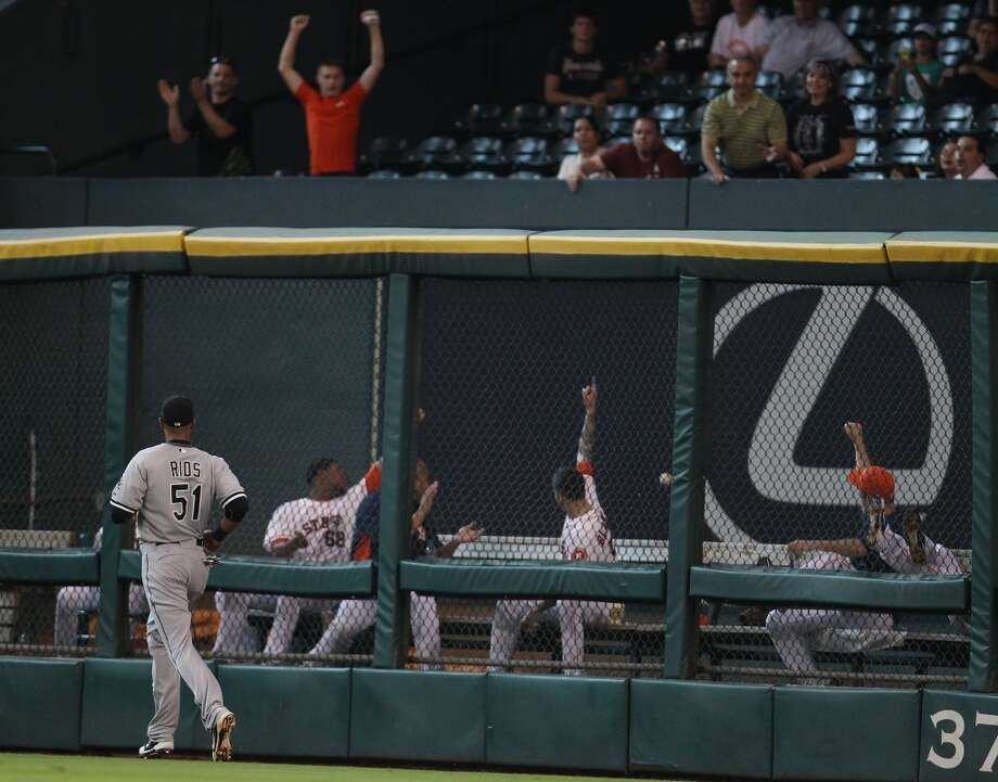 Astros bullpen points up and out as they react to Astros catcher Jason Castro's solo home run.