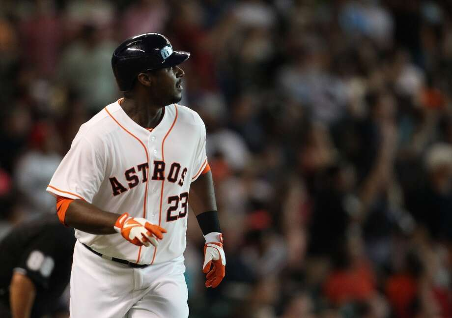 Astros left fielder Chris Carter watches his home run go up into the Crawford Boxes.