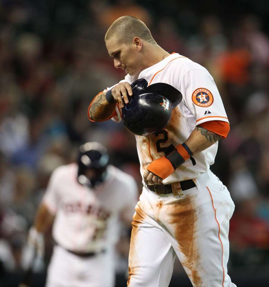 Astros center fielder Brandon Barnes reacts as he walks back to the dugout after getting thrown out at third.