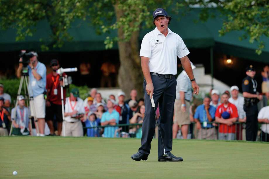 ARDMORE, PA - JUNE 15:  Phil Mickelson of the United States reacts on the 18th green during Round Three of the 113th U.S. Open at Merion Golf Club on June 15, 2013 in Ardmore, Pennsylvania. Photo: Rob Carr, Getty Images / 2013 Getty Images