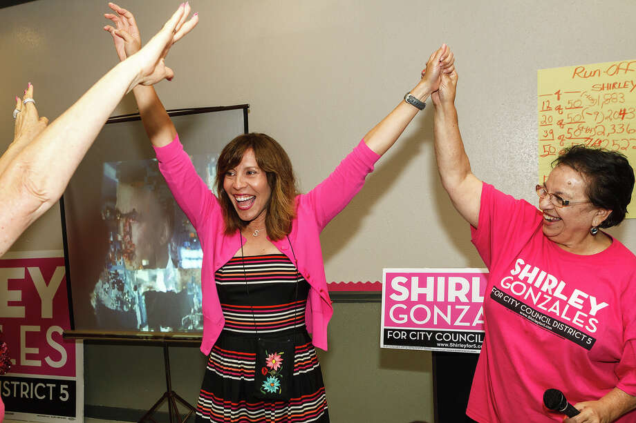 Shirley Gonzales (left) celebrates with campaign director Choco Meza at her campaign headquarters at 118 S. Sabinas on June 15, 2013, after learning she had defeated Councilman David Medina in the District 5 runoff election.   MARVIN PFEIFFER/mpfeiffer@express-news.net Photo: MARVIN PFEIFFER, San Antonio Express-News / Express-News 2013