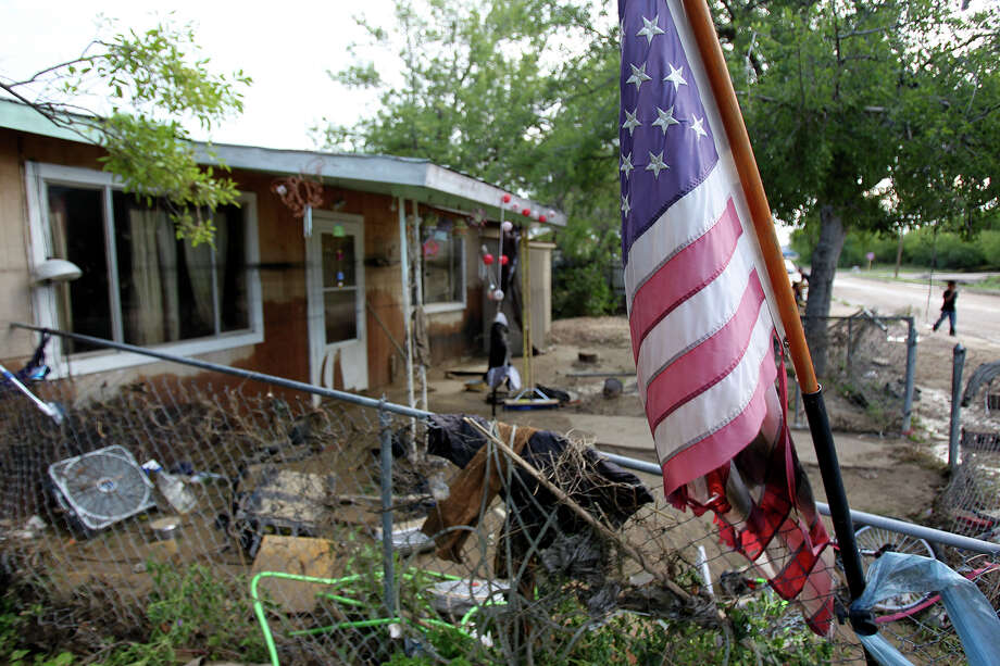 A home near Seco Creel shows the water lines of the flood during cleanup in the aftermath of flooding in Eagle Pass.  on  June 16, 2013. Photo: TOM REEL