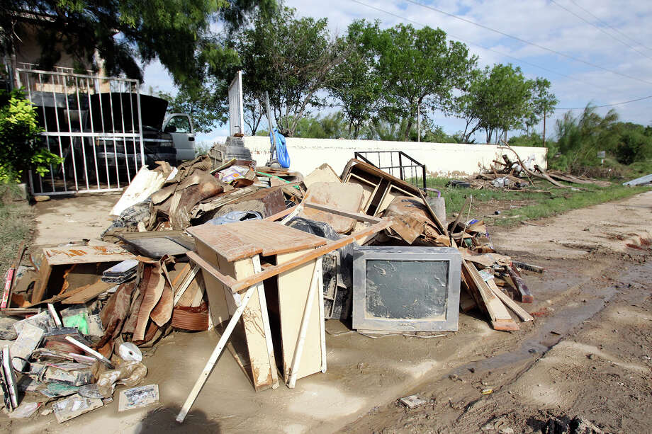 Contents of a home just beside Seco Creek are ruined and set out for garbage during the cleanup in the aftermath of flooding in Eagle Pass.  on  June 16, 2013. Photo: TOM REEL