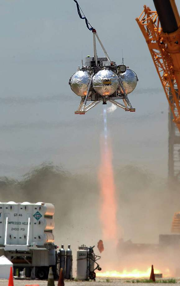 All recent tests of NASA's Morpheus lander have come tethered to a crane after a crash during its second free-flight test last August. Photo: Mayra Beltran, Staff / © 2013 Houston Chronicle