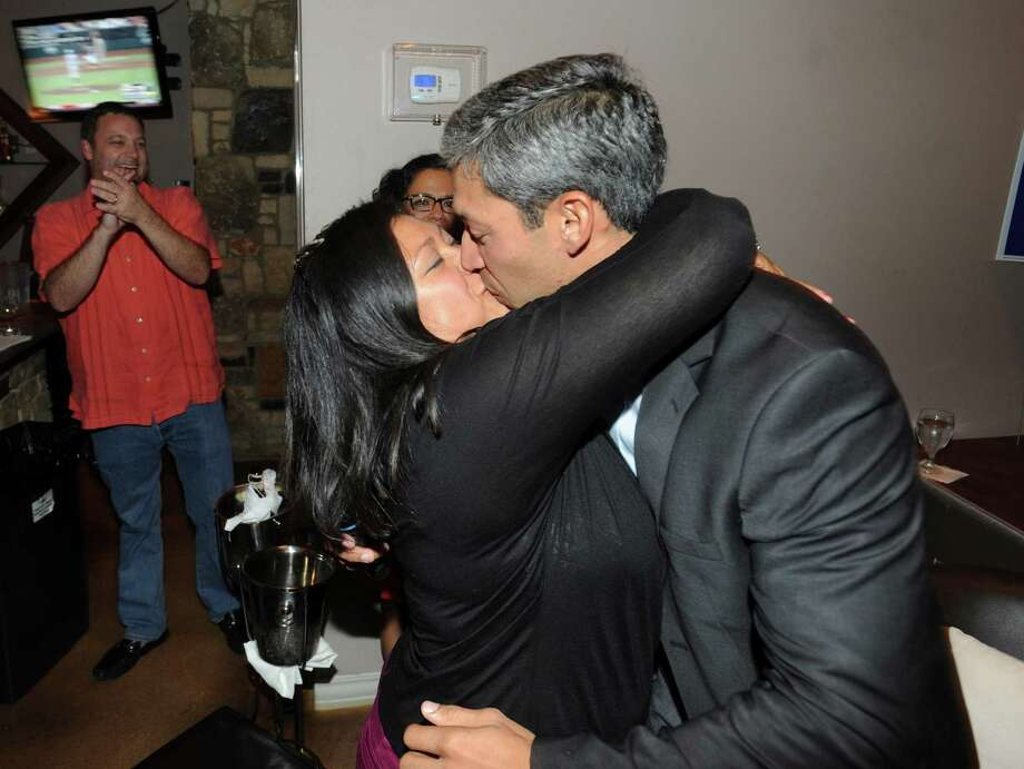 City Councilman-elect Ron Nirenberg kisses his wife, Erika Prosper, at his election watch party at Franco's Pizza on Saturday, June 15, 2013. Photo: Billy Calzada, San Antonio Express-News / San Antonio Express-News