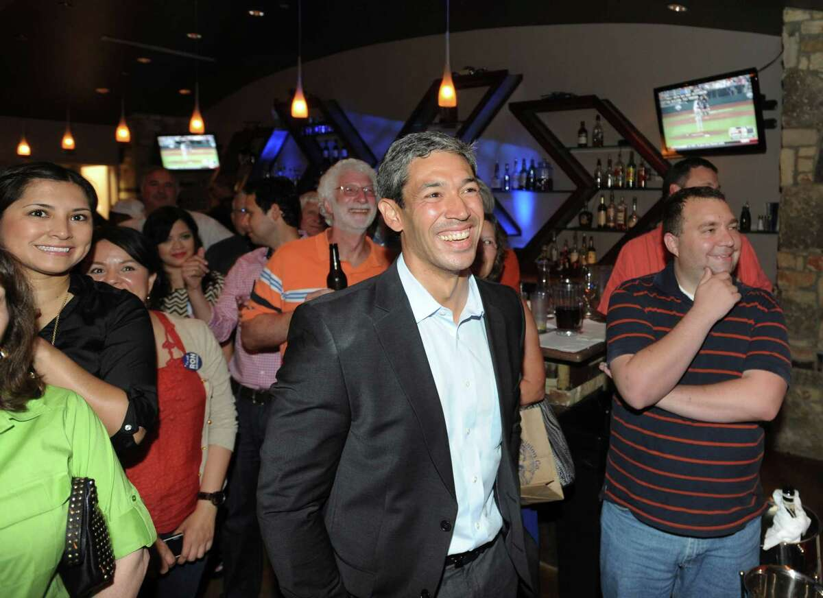 City Councilman-elect Ron Nirenberg listens as his wife, Erika Prosper, speaks about him at his election night watch party at Franco's Pizza on Saturday, June 15, 2013.