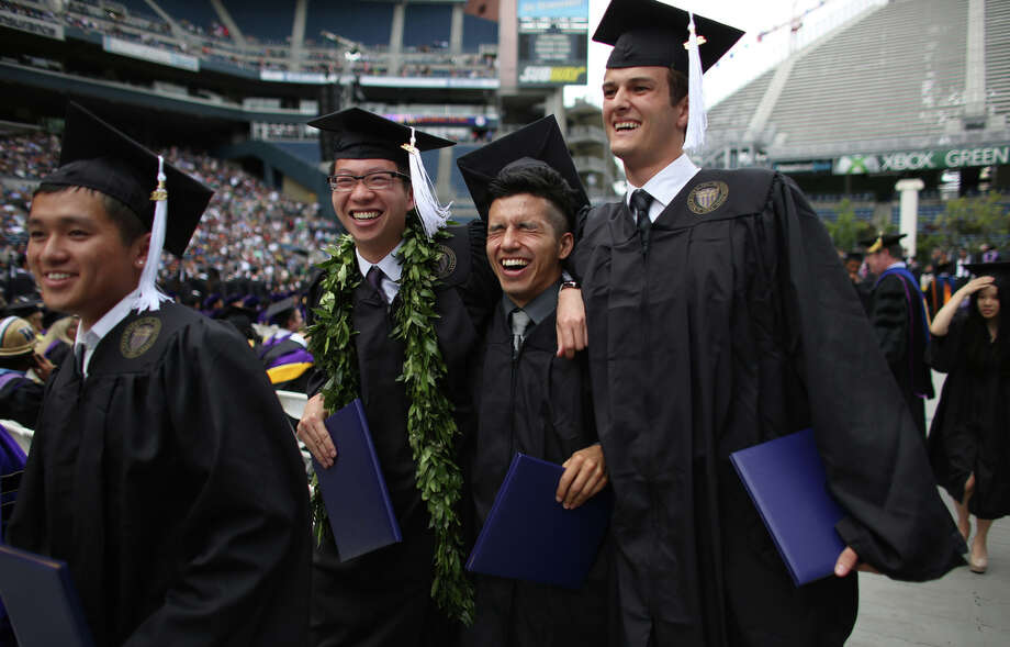 Undergraduates walk from the podium after receiving ceremonial degrees. Photo: JOSHUA TRUJILLO, SEATTLEPI.COM / SEATTLEPI.COM