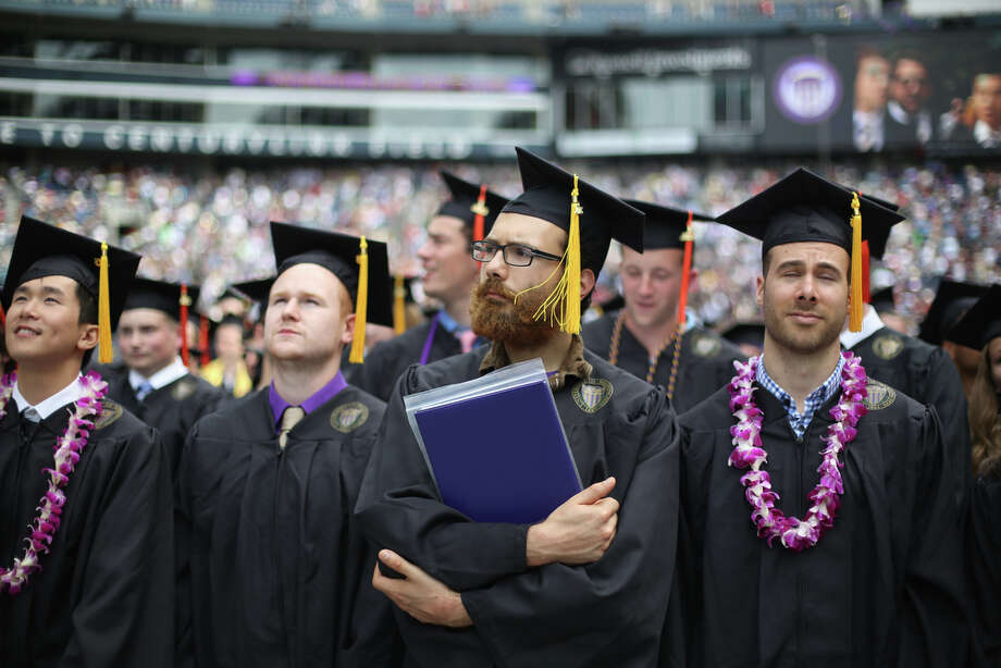 Graduates listen to the conclusion of the ceremony. Photo: JOSHUA TRUJILLO, SEATTLEPI.COM / SEATTLEPI.COM