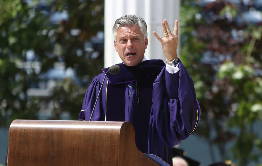 "Commencement speaker John Huntsman, former governor of Utah and ambassador to China and Singapore, gives his best try at the UW ""W."" Photo: JOSHUA TRUJILLO, SEATTLEPI.COM / SEATTLEPI.COM"