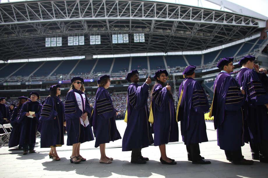 Doctoral graduates make their way to the podium. Photo: JOSHUA TRUJILLO, SEATTLEPI.COM / SEATTLEPI.COM