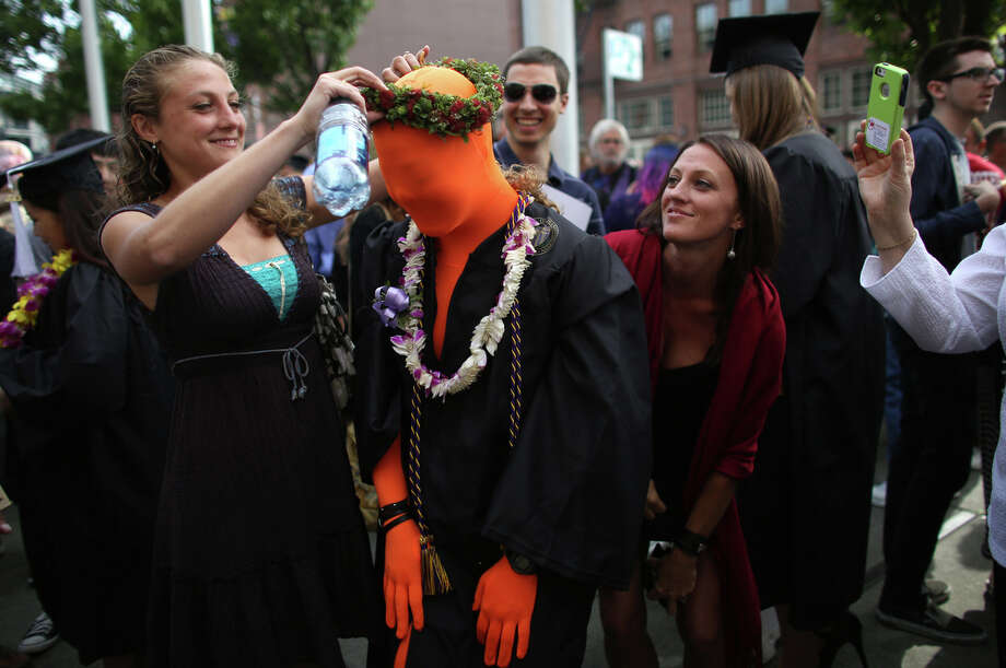 Giulia Anderson has her costume decorated by friends. She said she needed a way to be visible in the crowd, so she wore an orange suit. She also wore a gorilla suit to her high school prom, she said. Photo: JOSHUA TRUJILLO, SEATTLEPI.COM / SEATTLEPI.COM