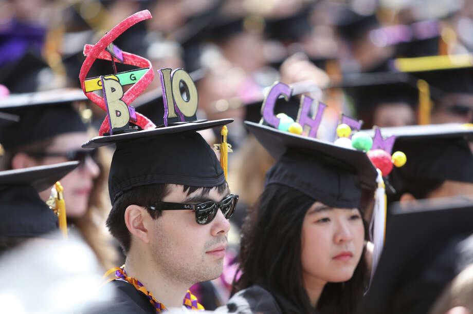 Graduates sport creative caps. Photo: JOSHUA TRUJILLO, SEATTLEPI.COM / SEATTLEPI.COM