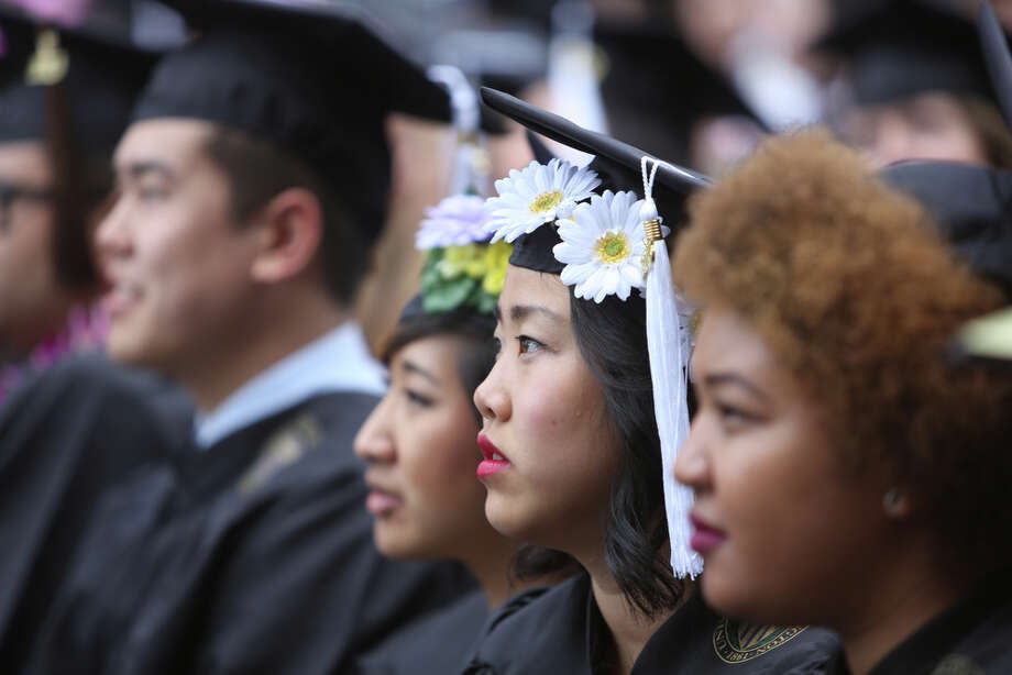 Graduates listen. Photo: JOSHUA TRUJILLO, SEATTLEPI.COM / SEATTLEPI.COM