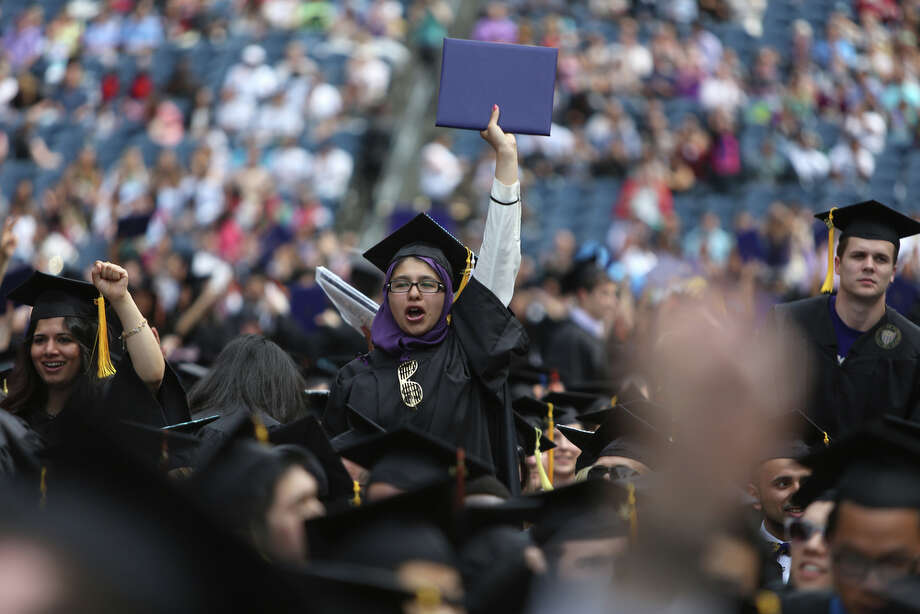 A graduate celebrates. Photo: JOSHUA TRUJILLO, SEATTLEPI.COM / SEATTLEPI.COM