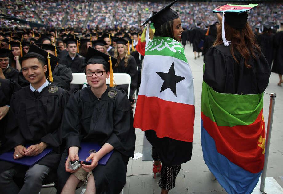 A pair of graduates wear flags. Photo: JOSHUA TRUJILLO, SEATTLEPI.COM / SEATTLEPI.COM