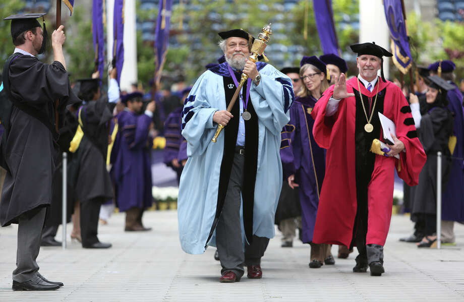 Philosophy professor Ronald Moore carries the University Mace. Photo: JOSHUA TRUJILLO, SEATTLEPI.COM / SEATTLEPI.COM